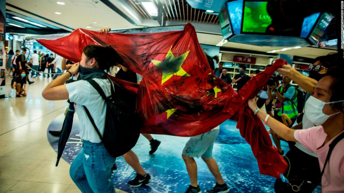 Violence spreads as Hong Kong protests enter 16th week