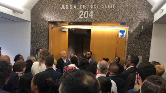Onlookers were turned away from the courtroom after it reached capacity.