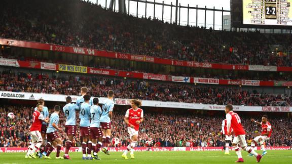 Emerick Aubameyang of Arsenal scores his team's scores his team's third goal against Villa.