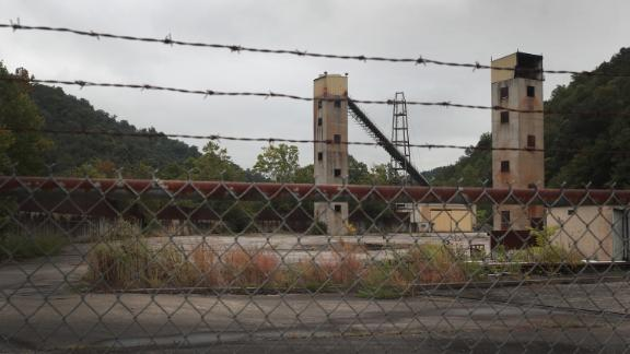 WHITESBURG, KENTUCKY - AUGUST 23: A fence surrounds the remains of a shuttered coal mine on August 23, 2019 near Whitesburg, Kentucky. Many communities in Eastern Kentucky that rely heavily on a coal economy are seeing that lifeblood rapidly slip away. The region has lost more than 15 percent of its mining jobs in the past year and less than two thirds of the jobs remain from a decade ago. Recently, more than 300 miners in Harlan County lost their jobs when Blackjewel LLC declared bankruptcy.   (Photo by Scott Olson/Getty Images)
