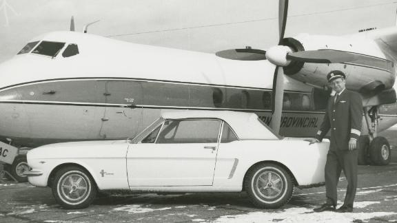 Tucker stands next to the car in 1966.