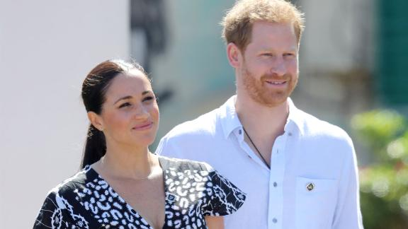 Meghan, Duchess of Sussex and Prince Harry, Duke of Sussex smile as they visit a Justice Desk initiative in Nyanga township, during their royal tour of South Africa on September 23, 2019 in Cape Town, South Africa. The Justice Desk initiative teaches children about their rights and provides self-defence classes and female empowerment training to young girls in the community.