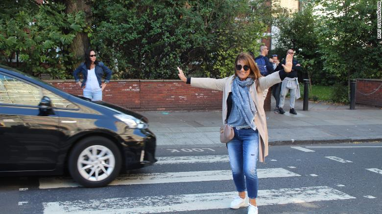Karen Abramson, a photographer who grew up in Liverpool, poses mid-traffic.