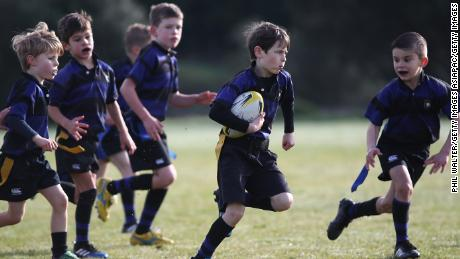 Children play rugby during an Auckland Rippa Rugby Junior Rugby match at Cox's Bay Reserve on August 5, 2017, in Auckland, New Zealand.