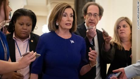 Speaker of the House Nancy Pelosi is questioned by reporters as she departs the Capitol en route to a speaking event in Washington, Tuesday, September 24, 2019.
