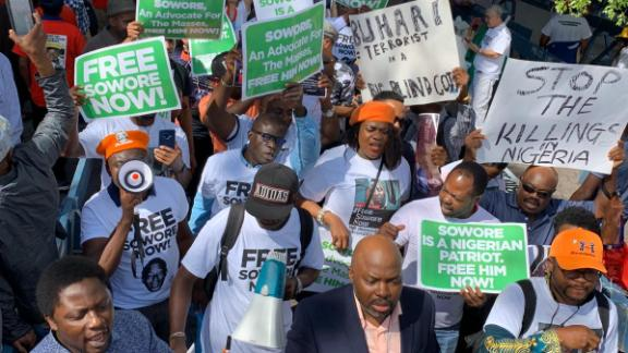 This picture taken on September 24, 2019 shows protesters marching from the Nigerian House to the UN Plaza in New York calling for release of detained journalist Omoyele Sowore who has been charged with treason.