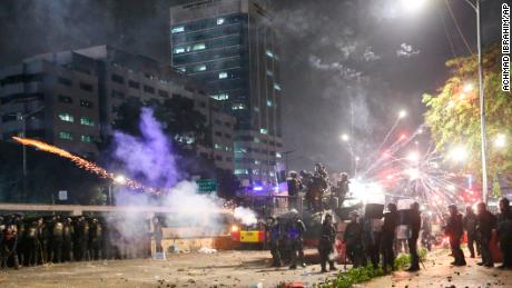 Indonesian riot police fire tear gas to disperse student protesters during a clash outside parliament in Jakarta, Indonesia, on September 24, 2019.