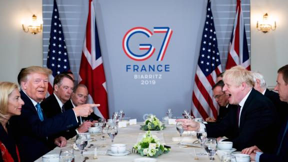 Trump shares a laugh with UK Prime Minister Boris Johnson during a working breakfast at the G-7 summit in Biarritz, France, in August 2019.