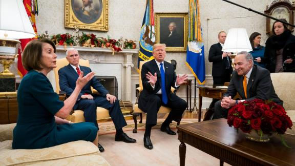 """Trump and Vice President Mike Pence meet with House Minority Leader Nancy Pelosi and Senate Minority Leader Chuck Schumer at the White House in December 2018. In the meeting, part of which was open to the press, <a href=""""https://www.cnn.com/2018/12/11/politics/trump-pelosi-schumer-meeting-shutdown/index.html"""" target=""""_blank"""">Trump clashed with Schumer and Pelosi over funding for a border wall </a>and the threat of a government shutdown. Parts of the federal government did eventually shut down. <a href=""""https://www.cnn.com/2018/12/22/politics/gallery/government-shutdown-december-2018/index.html"""" target=""""_blank"""">The shutdown</a> lasted a record 35 days."""