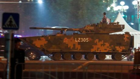 A soldier mounted on an army tank in Beijing on September 21 during rehearsals for the October 1 military parade.