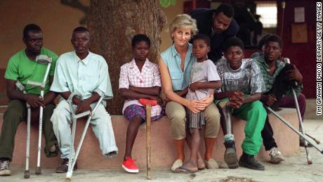 During her visit 22 years ago, the late Princess of Wales, pictured here with children injured by landmines, also visited Neves Bendinha Orthopaedic Workshop In Luanda, Angola.