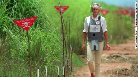 Diana made her way past red flags warning of live landmines during a visit to Huambo, Angola, in 1997.