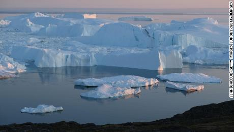 ILULISSAT, GREENLAND - AUGUST 04: Icebergs and ice float in the Ilulissat Icefjord on August 04, 2019 near Ilulissat, Greenland. The Sahara heat wave that recently sent temperatures to record levels in parts of Europe has also reached Greenland. Climate change is having a profound effect in Greenland, where over the last several decades summers have become longer and the rate that glaciers and the Greenland ice cap are retreating has accelerated.   (Photo by Sean Gallup/Getty Images)