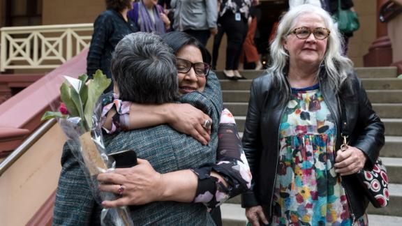 MP's Jenny Leong and Mehreen Faruqi embrace outside Parliament after the passing of the bill to decriminalize abortion on September 26, 2019 in Sydney, Australia.