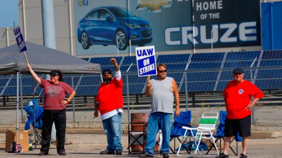 Picketers carry signs at one of the gates outside the closed General Motors automobile assembly plant, Monday, Sept. 16, 2019, in Lordstown, Ohio. (AP Photo/Keith Srakocic)