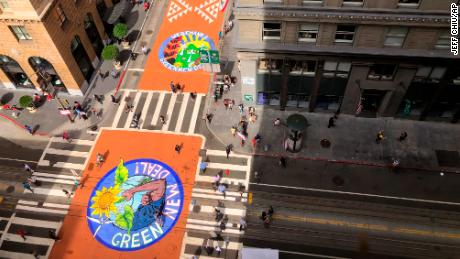 Climate activists painted murals on Montgomery Street in San Francisco.