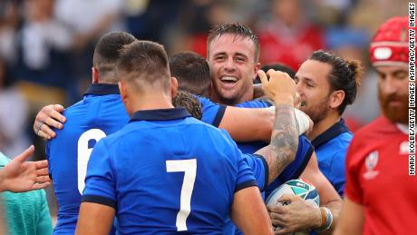 Italy celebrates during its win over Canada.