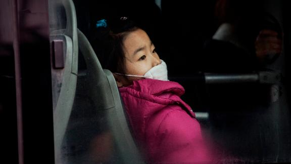 A girl wears a mask to protect against pollution on December 8, 2015 in Beijing, China.