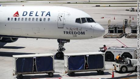 A Delta Air Lines plane. A Delta employee was arrested on Thursday in connection with the theft of $250,000 bound for Miami on a Delta flight.