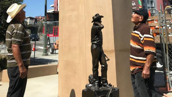 Ramon Zapata, 82, and Leobardo Villa, 85, both former participants in the Bracero Program, look at the pedestal where a monument honoring braceros will be unveiled in Los Angeles. A smaller-scale model of the monument is also at the site.