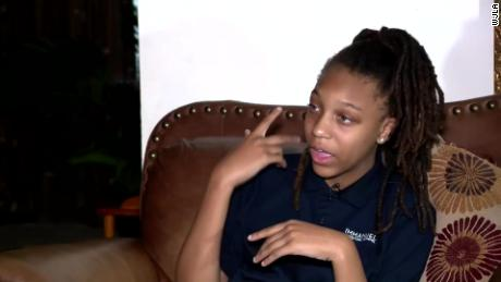 A 12-year-old African-American girl says her white classmates pinned her down and cut her dreadlocks