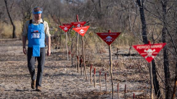Harry walks through a minefield in Dirico, Angola, on Friday, before traveling to the site of his mother