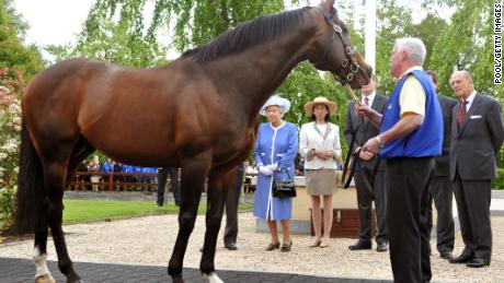 KILDARE, IRELAND - MAY 19:  Queen Elizabeth II and Prince Philip, Duke of Edinburgh during a visit to the Irish National Stud, one of Ireland's top horsebreeding centres, during the third day of the state visit to Ireland, on May 19, 2011 in Kildare, Ireland. The Duke and Queen's visit to Ireland is the first by a monarch since 1911. An unprecedented security operation is taking place with much of the centre of Dublin turning into a car free zone. Republican dissident groups have made it clear they are intent on disrupting proceedings.  (Photo by John Stillwell - Pool/Getty Images)