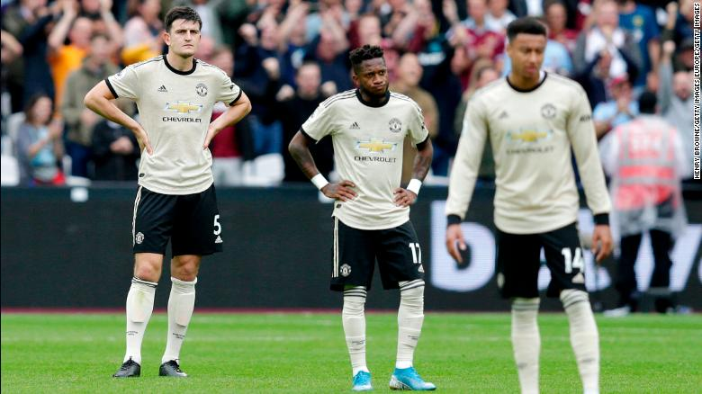 Fred (C) of Manchester United looks dejected with Harry Maguire (L) during September's defeat at West Ham.
