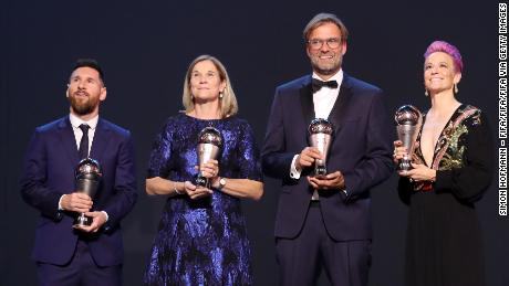 Lionel Messi, Jill Ellis, Jurgen Klopp and Megan Rapinoe with their FIFA awards.