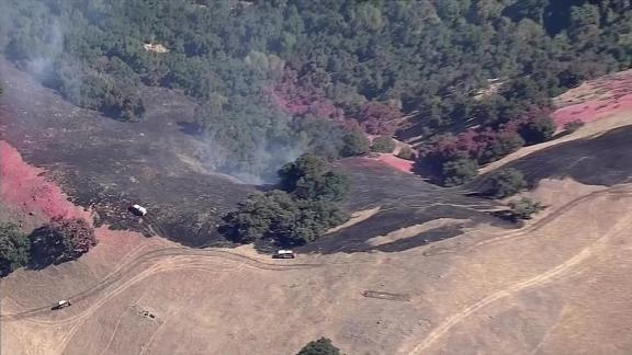 The Reservoir Fire burned 128 acres near Milpitas in northern California.