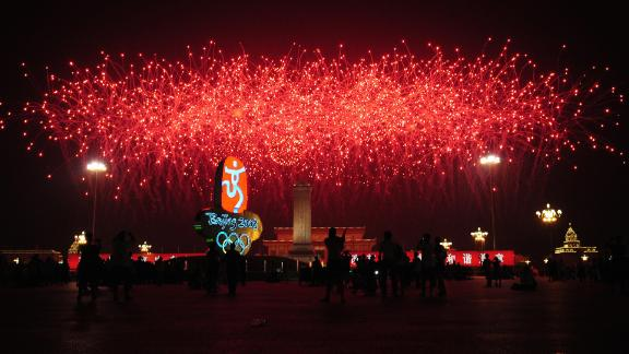 """Fireworks explode over the National Stadium, also known as the """"Bird's Nest"""",  during the opening ceremony of the 2008 Beijing Olympic Games."""