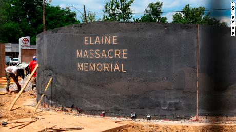 In this June 2019 photo, men work near the monument in Helena, Arkansas, which will honor the victims of the Elaine Massacre. The Helena monument sits across from the Phillips County courthouse.