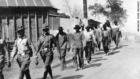 Federal troops escorting African Americans to the schoolhouse in Elaine; October 1919