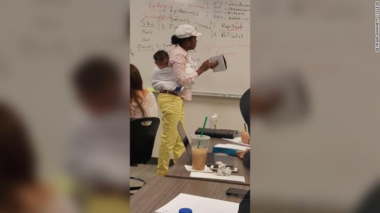 College professor Ramata Sissoko Cissé teaches an anatomy course with one of her student's children strapped to her back.