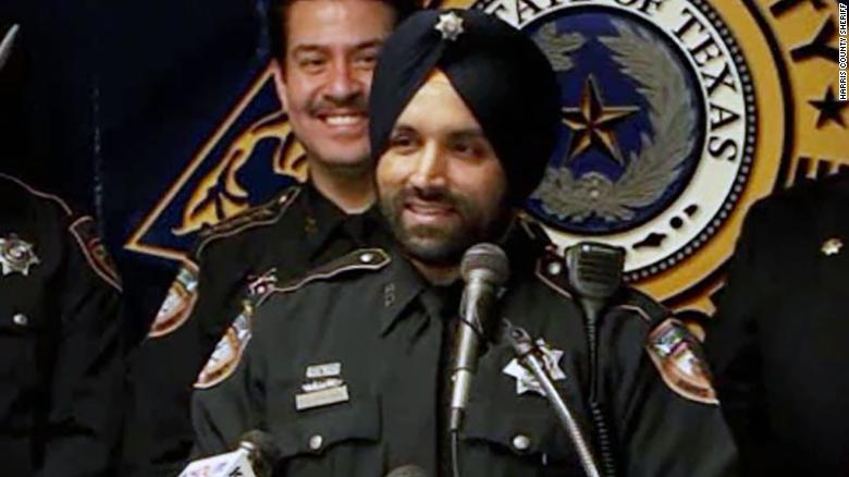 """Harris County deputy Sandeep Dhaliwal was shot """"from behind... at least a couple of times"""" while conducting a traffic stop, the sheriff said earlier Friday a news conference."""