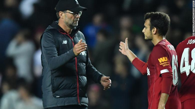 Liverpool's manager Jurgen Klopp celebrates with Spanish midfielder Pedro Chirivella at the final whistle of the English League Cup win over MK Dons.