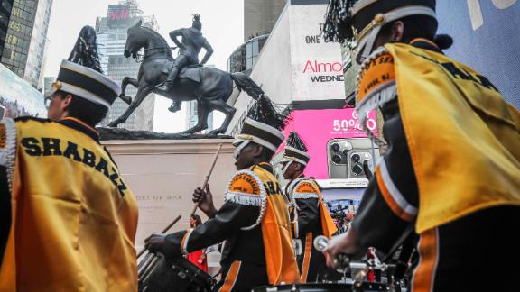 """Members of the Malcom Shabazz High School marching band, from Newark, New Jersey, perform at the the unveiling of artist Kehinde Wiley's sculpture """"Rumors of War."""""""