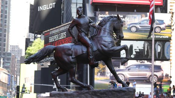 """The sculpture """"Rumors of War"""" is unveiled in New York City's Times Square on September 27, 2019."""
