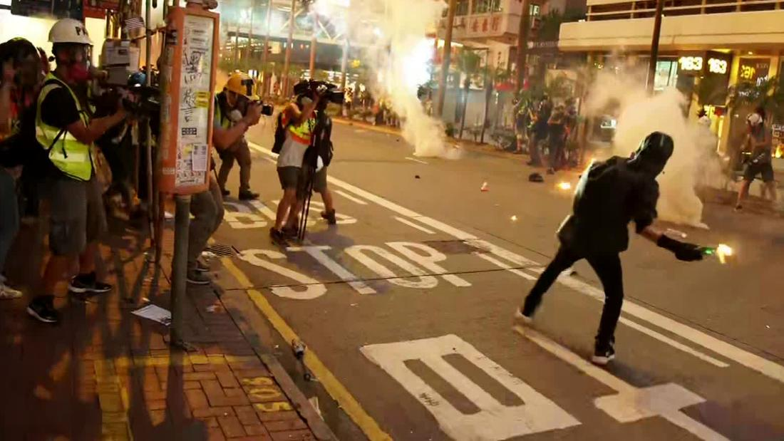 Hong Kong police and protesters clash ahead of 70th anniversary of People's Republic of China