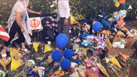 A vigil was held in Houston on Saturday at the scene where Dhaliwal was shot.
