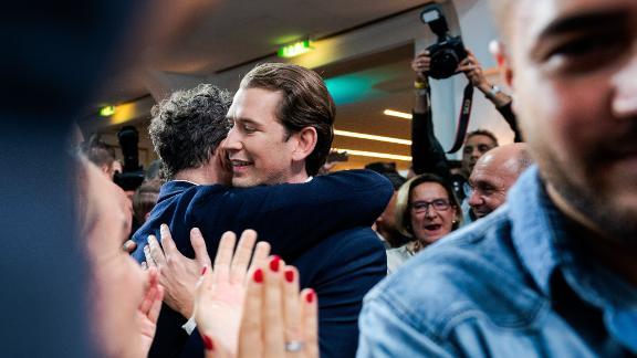 Sebastian Kurz hugs a supporter after the results were announced.