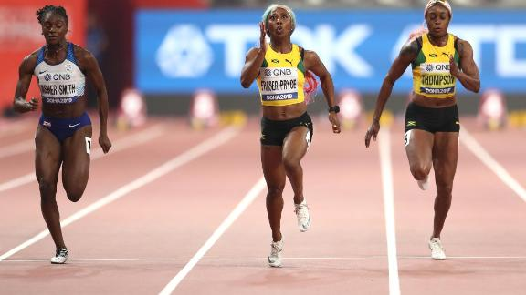 Fraser-Pryce held off the challenge of Britain's Dina Asher-Smith (L)