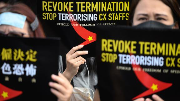 Protesters take part in a rally to support Cathay Pacific staff in Hong Kong after some of the airline
