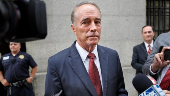 In this September 12, 2019 file photo, U.S. Rep. Chris Collins, R-N.Y., speaks to reporters as he leaves the courthouse after a pretrial hearing in his insider-trading case, in New York.