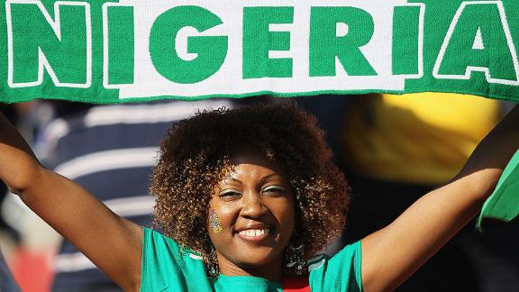 JOHANNESBURG, SOUTH AFRICA - JUNE 12: A Nigeria fan proudly holds her scarf ahead of the 2010 FIFA World Cup South Africa Group B match between Argentina and Nigeria at Ellis Park Stadium on June 12, 2010 in Johannesburg, South Africa. (Photo by Christof Koepsel/Getty Images)