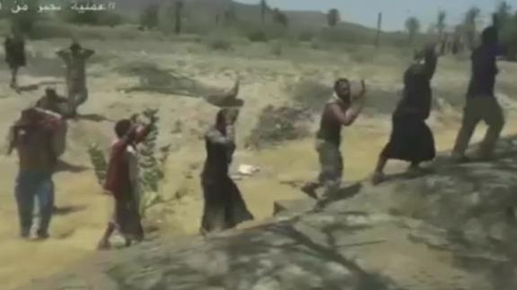 A screengrab from footage via Houthi-run Al Masirah TV purportedly shows soldiers surrendering to Houthi rebels near the Saudi Arabia-Yemen border.