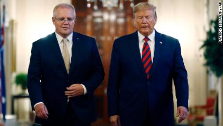 President Donald Trump walks with Australian Prime Minister Scott Morrison into the East Room of the White House for a news conference, September 20, 2019, in Washington.