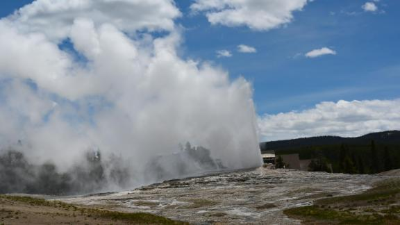 Old Faithful geyser erupts in Yellowstone National Park in Wyoming on June 11, 2019. - Old Faithful has erupted every 44 to 125 minutes since 2000. (Photo by Daniel SLIM / AFP)        (Photo credit should read DANIEL SLIM/AFP/Getty Images)