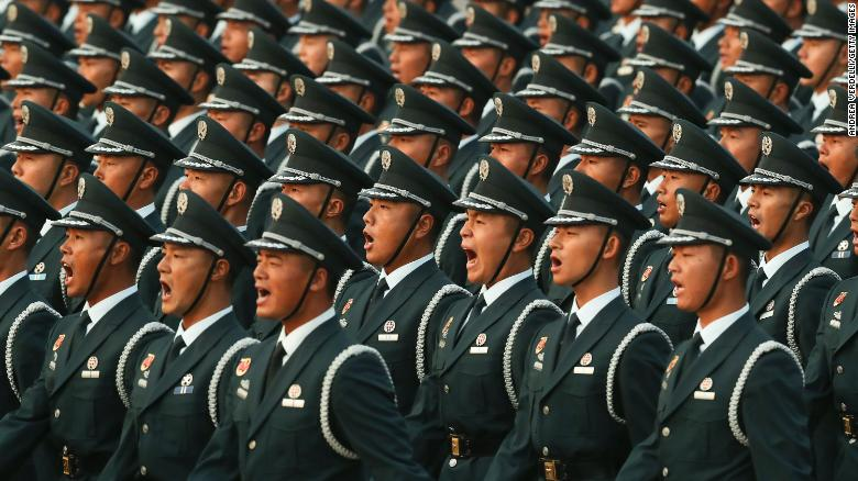 Soldiers of the People's Liberation Army shout during the rehearsal of the parade early morning on October 01, 2019, in Tiananmen Square.
