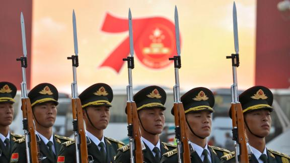 Members of a Chinese military honor guard stand at attention during a rehearsal before a large parade to commemorate the 70th anniversary of the founding of Communist China in Beijing, Tuesday, Oct. 1, 2019. Chinese Communist Party leader and President Xi Jinping on Monday renewed his government's commitment to allowing Hong Kong to manage its own affairs amid continuing anti-government protests in the semi-autonomous Chinese territory.
